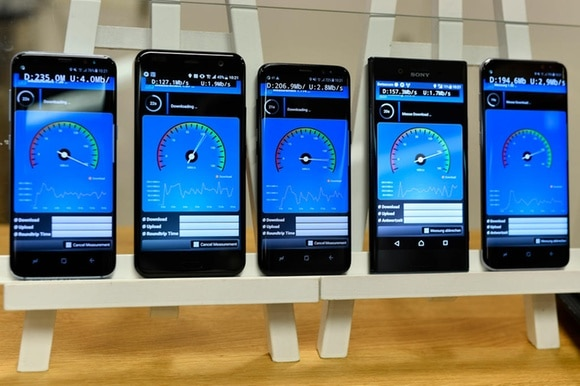 Mobile phones display download rates at a Swisscom media conference on the 5G network in Zurich on Wednesday, June 28, 2017