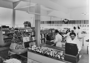 The inside of a detail shop with products and and women at the checkout terminals