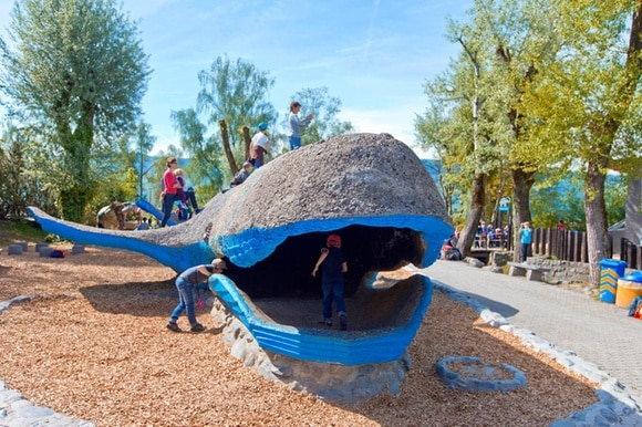Children play with the concrete whale on the playground at the Knie children s zoo in Rapperswil