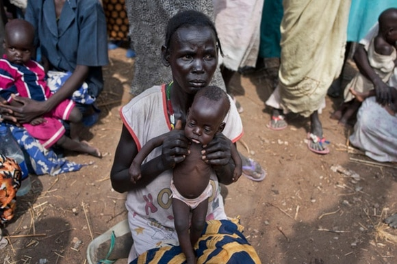 South Sudanese woman and baby in feeding centre