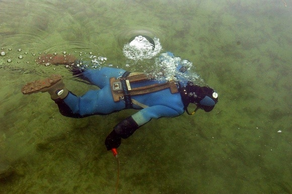 A picture of a diver in a lake