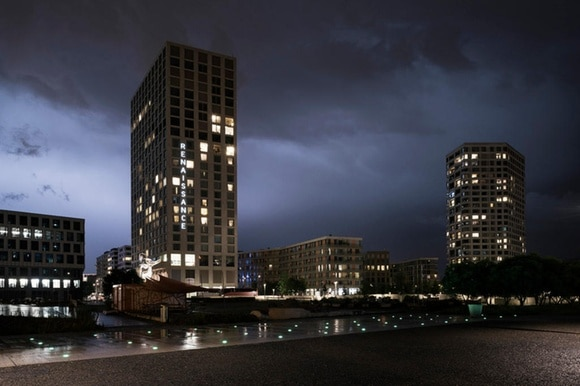 Night time scene of urban tower blocks lit up.