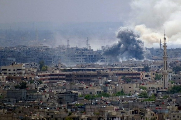 A Syrian army airstrike targets the Islamic State-held Hajar al-Aswad neighborhood in Damascus