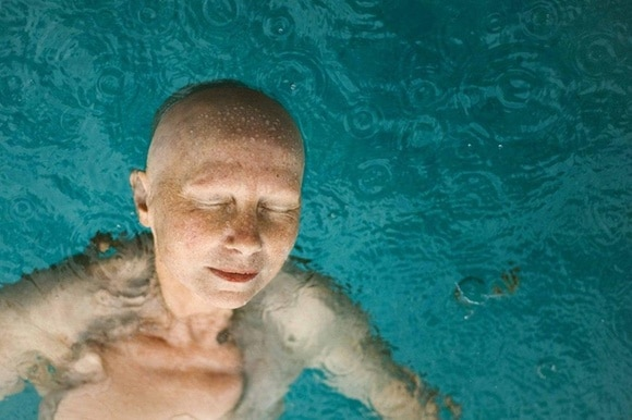 Woman floats in water