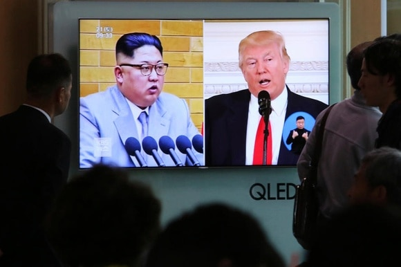 Footage of US President Donald Trump (right) and North Korean leader Kim Jong Un
