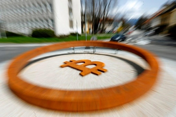 Cars pass a roundabout with the allegedly world s first Bitcoin monument in Kranj, Slovenia
