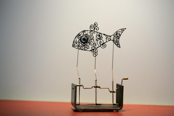 wire fish with turning handle