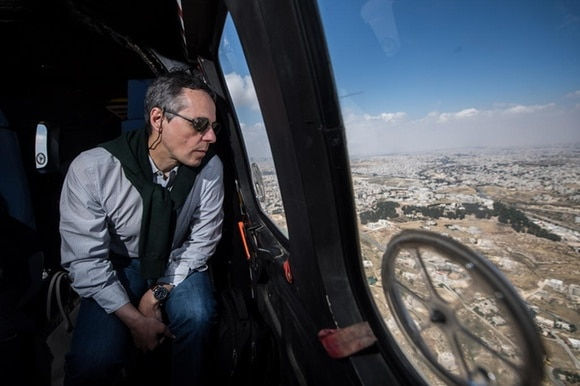 Ignazio Cassis in a helicopter over Jordan