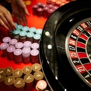 A person prepares a roulette table at a Zurich casino.