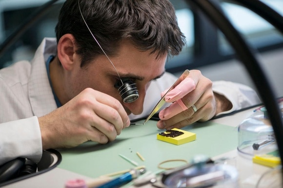 A Swiss watchmaker at work