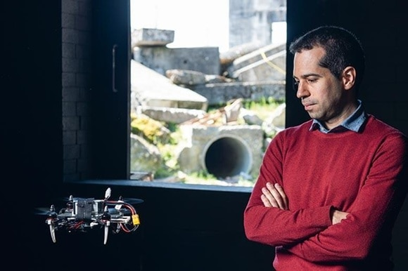 Portrait of Davide Scaramuzza with a flying drone