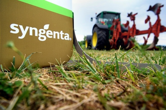 Tractor in a field behind the sign Syngenta