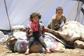 Two children in a refugee camp in Syria