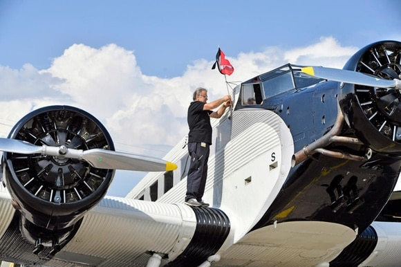 A worker prepares a JU-52 vintage plane in Dübendorf, Zurich, on August 17, 2018, ahead of the resumption of operations
