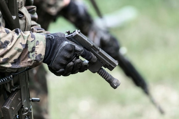weapons training close up of hand with gun