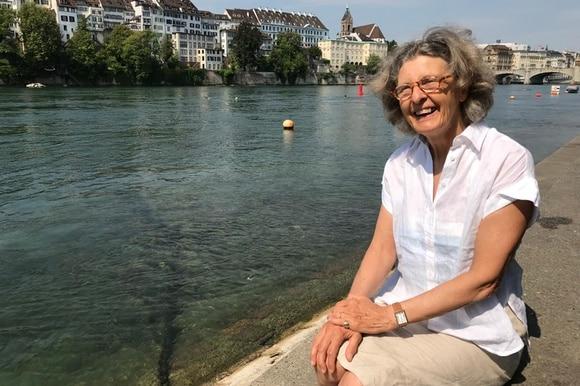 woman sitting on riverbank