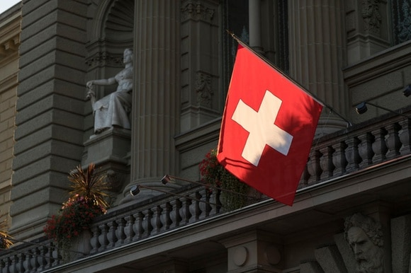 A Swiss flag flies outside the Federal Palace in Bern