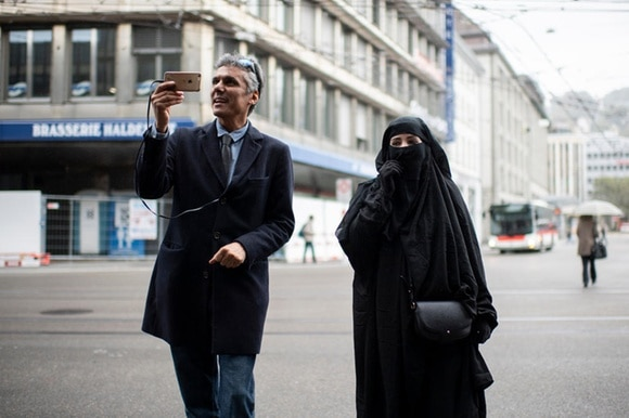 Algerian businessman and political activist Rachid Nekkaz in St. Gallen on Wednesday with a woman in a burka.