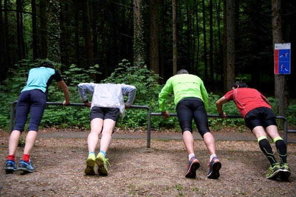 People on a fitness trail in a forest
