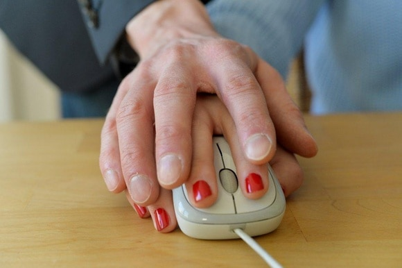 two hands on mouse