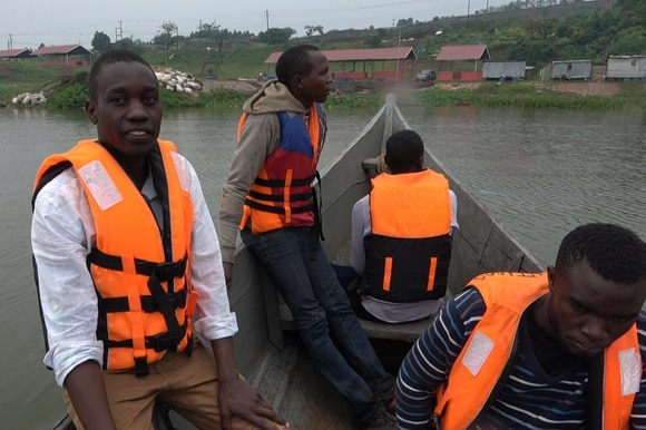 David and crew return from inspecting fish cages on Lake Victoria
