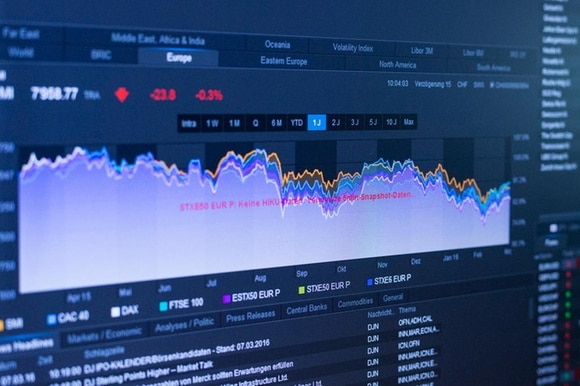 Stock exchange screen shows trading charts