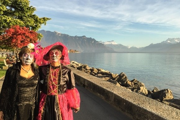 Two women in costume on the lake