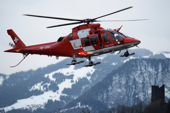 Rega rescue helicopter in mountains