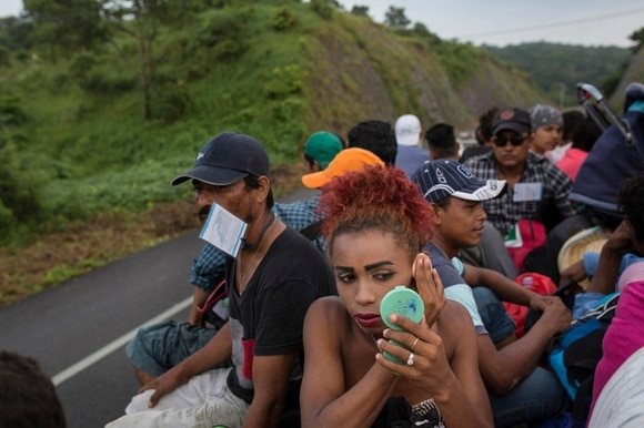 Group of Honduran migrants on a truck in Mexico