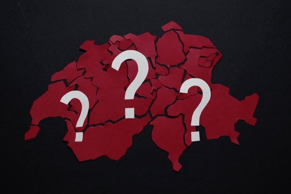 Map of Switzerland with question marks on it