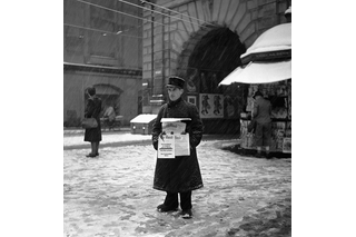 Newspaper seller in snow
