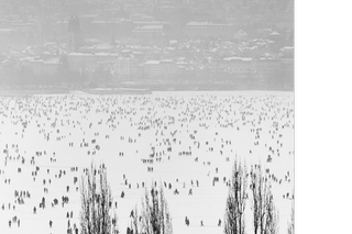 Crowd on frozen lake