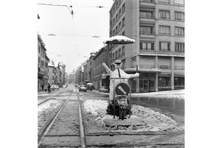 snowman next to tram tracks