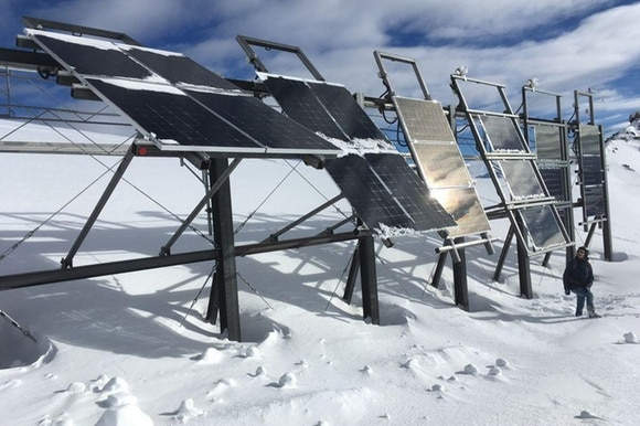 Solar panels on snowy mountain top