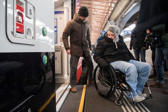 Wheelchair user getting off a train