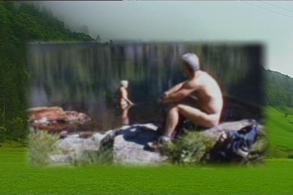 Two naked men take a break while hiking