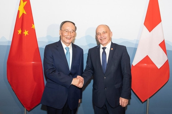 Chinese Vice President Wang Qishan (left) and Swiss President Ueli Maurer