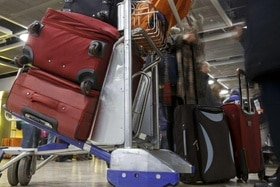 Suitcases on an airport trolley