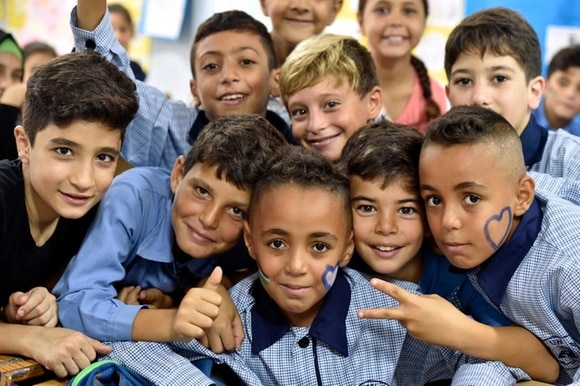 Palestinian students pose for a photo in a Kabri School, Lebanon