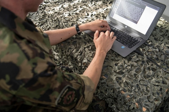 A soldier using a computer