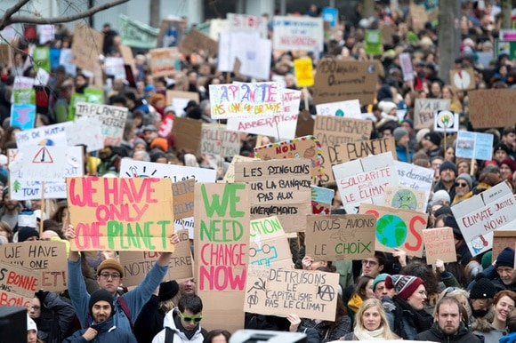 demonstrators march through Lausanne with banners for the climate