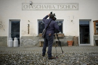Cameraman in a village