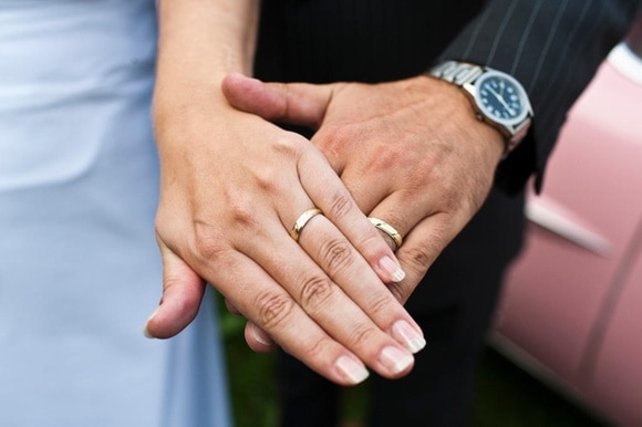 two hands of people getting married