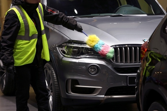 A car being cleaned at the Geneva Motor Show