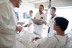 Medical staff during a ward round in a hospital