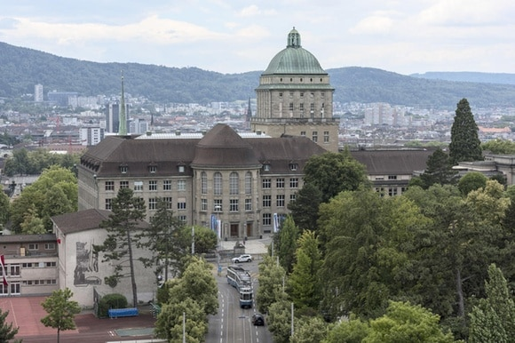 The main building of the University of Zurich with the city of Zurich in the background