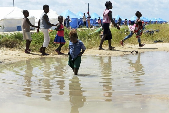 Children playing near water in Mozambique