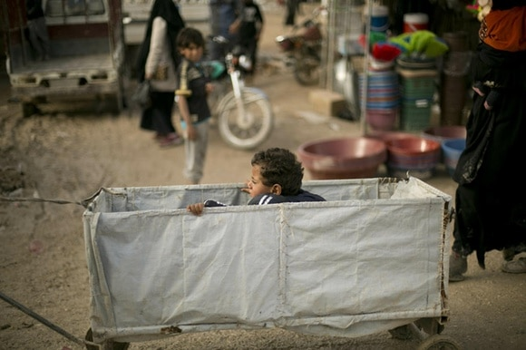 A child rides in a makeshift cart at Al-Hol camp in Syria on March 31, 2019