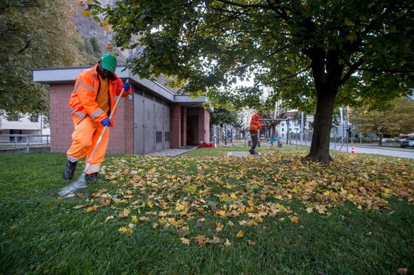 Asylum seekers clean a park in Biasca, canton Ticino, in 2017