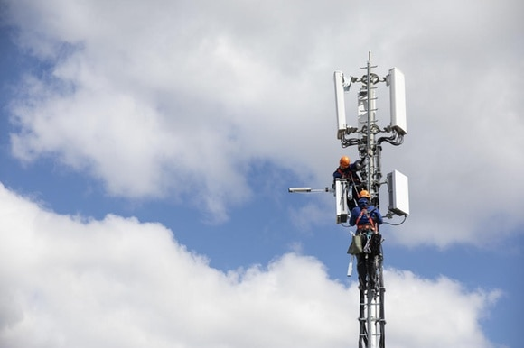 Workers on an antenna
